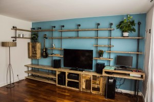 Industrial reclaimed timber and vintage style pipe shelving and storage system with desk
