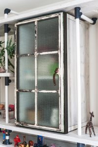 vintage metal panelled window frame glazed with fire safety glass