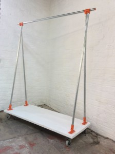 Bespoke triangle shape reclaimed scaffolding clothes rail with powder coated fittings