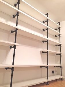 Reclaimed pine and powder coated steel pipe bookcase