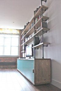 Made to order reclaimed industrial scaffolding board storage with painted glass doors with shelves supported by dark steel