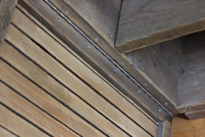 Close up of reclaimed scaffolding media unit with slatted wood