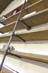 Bespoke reclaimed scaffolding shelf supported with dark threaded pipe and fixings