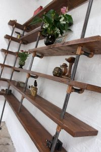 Bespoke industrial material floor and wall mounted shelving unit with bronze threaded fittings