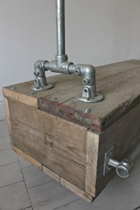Industrial style galvanised steel pipe clothes rail with reclaimed scaffolding timber drawer unit base