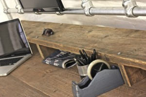 Reclaimed timber desk with steel pipe legs and shelves and a monitor mounting frame