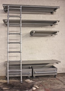 Industrial style wall shelves with hanging rails beneath and lower storage drawers