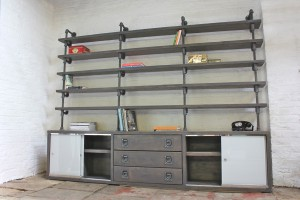 Made to Measure Industrial double sliding glass door cupboards and central timber drawer unit, with graphite steel pipe and grey washed reclaimed scaffolding board timber bookcase on top