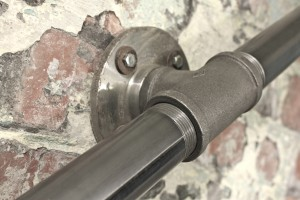 Close up of Industrial Dark Steel Pipe Staircase Hand Rail or Wall Mounted Banister