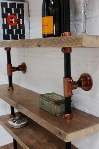 Bespoke wall mounted shelving made from industrial materials and copper powder coated fittings