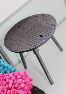 Reclaimed manhole covered side table with steel legs