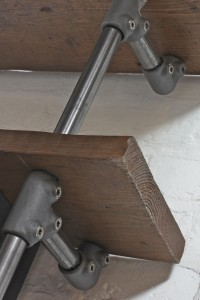 Mounted reclaimed scaffolding shelves with pipe