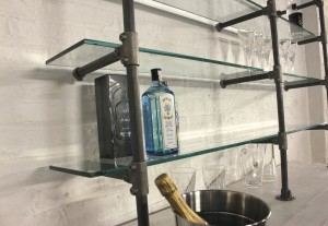Bespoke industrial reclaimed scaffolding sideboard with chunky glass shelving