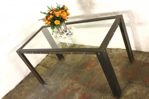 Industrial style glass topped table