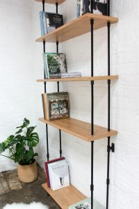 Industrial bespoke bookcase with veneered shelves and powder coated steel