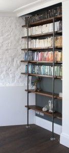 Urban mounted reclaimed scaffolding and steel pipe shelving