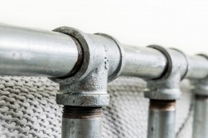 Close Up Of Industrial Galvanised Steel Pipe and Industrial Threded Fittings Kingsize Bed Frame