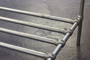 Close up of a steel pipe bed-frame base