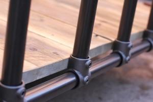 bespoke urban dark steel pipe bed-frame with reclaimed scaffolding board base