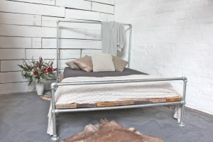 galvanised steel pipe bed-frame with reclaimed scaffolding board base