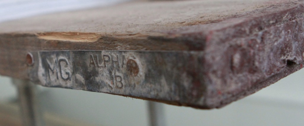 Close up of reclaimed scaffolding board table