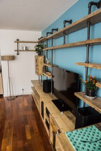 Industrial reclaimed scaffolding plank and dark steel pipe shelving and storage system with desk