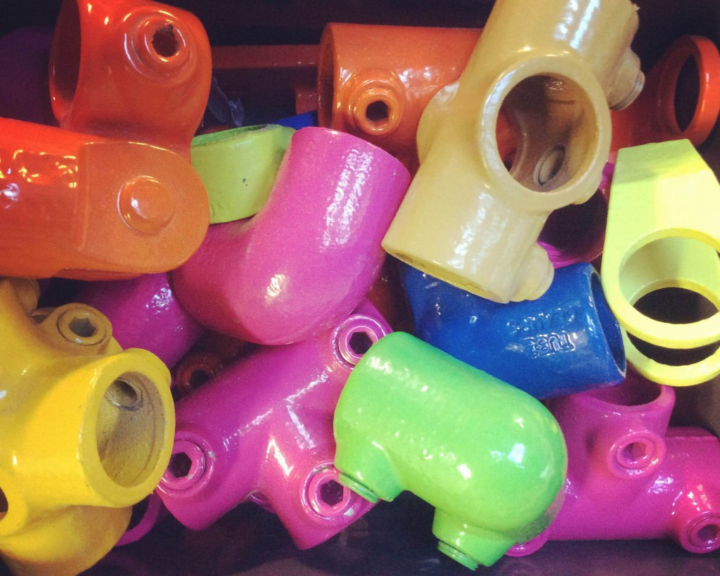 array of different colour powder coated pipe fittings