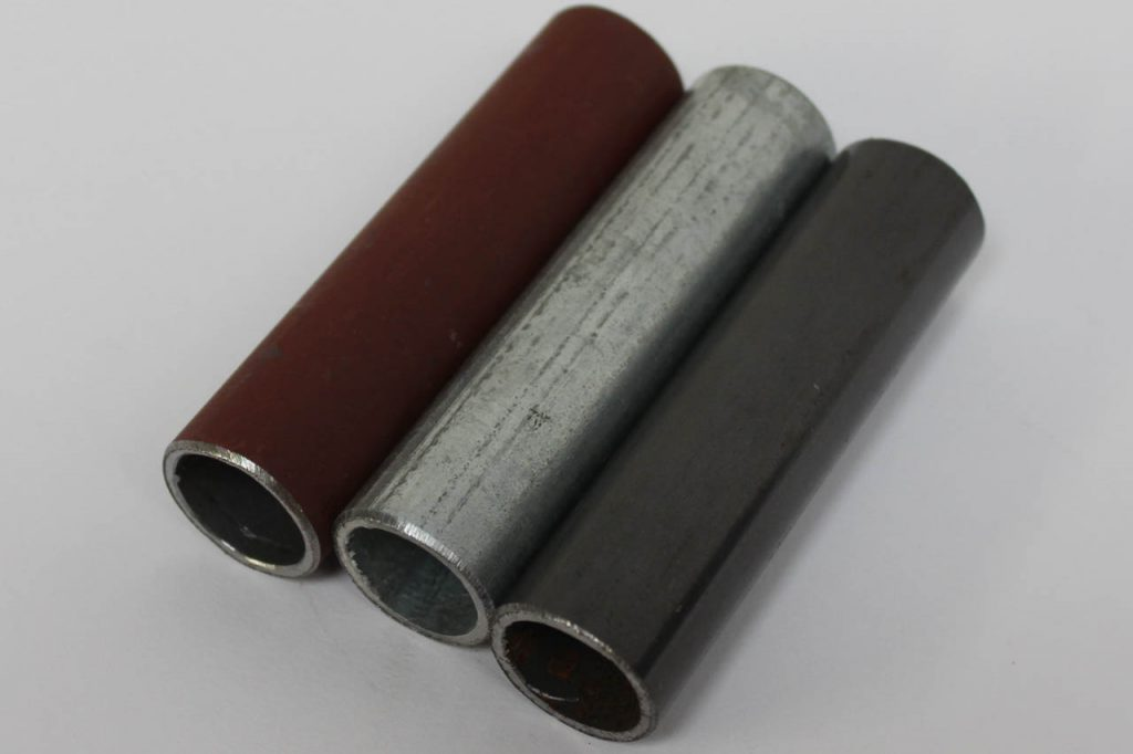 Photograph of different finishes on steel pipe