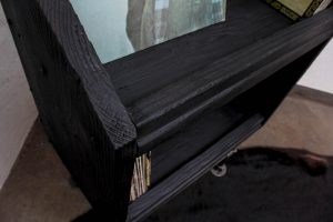 charred scaffolding vinyl storage unit